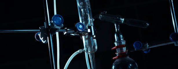 Laboratory glassware over black background