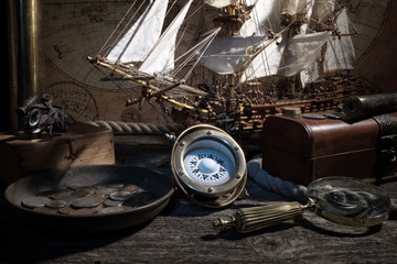 Sailboat, compass, old coins and sextants. Travel and marine engraving background. Treasure hood concept. Retro style.