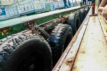 Tire To Prevent The Terminal From Damaging The Ferry On The Chao Phraya River Bangkok Thailand
