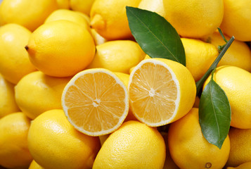 fresh lemons as background, top view