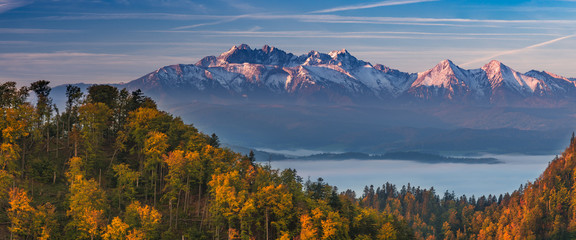 Tatra mountains panorama over autumn forest in the morning, Poland