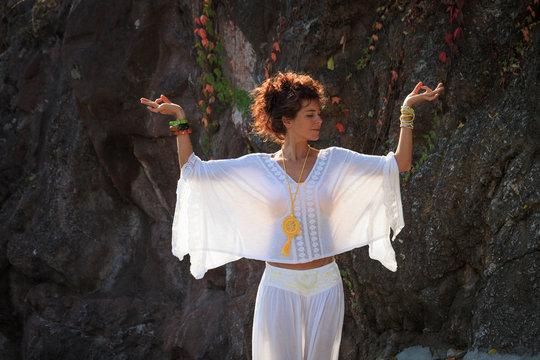 woman practice yoga outdoor autumn day hands in mudra  gesture