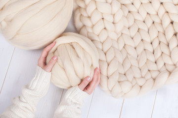 a ball of thick yarn and a blanket of thick wool