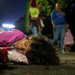 A girl, part of a caravan of thousands of migrants from Central America en route to the United States sleeps, in Tapachula, Mexico