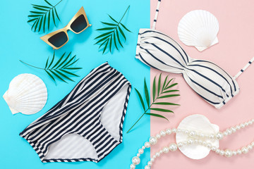 Summer holidays flat lay on blue and pink background