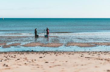 Two men Fishing on Hornsea Beach