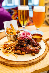 grilled ribs with french fries