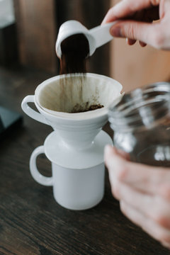 Pour ground coffee into a pour over cone and filter