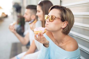 Beautiful woman eating a donut