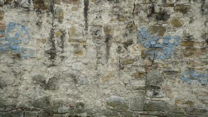 Fotobehang Oude vuile getextureerde muur Background of weathered brick wall with cracks and peeling plaster
