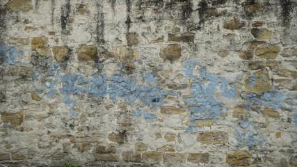 Fotobehang Oude vuile getextureerde muur Background of old vintage brick wall with blue paint and peeling plaster