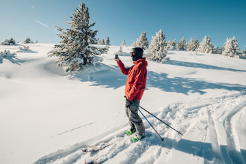 freerider telemarks in deep powder on snowcovered mountains