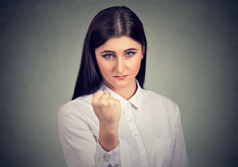 Angry woman threatening with fist