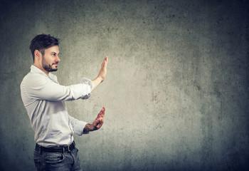 Bearded man making stop gesture