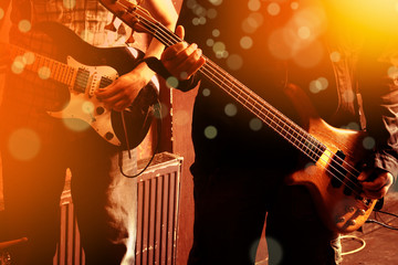 Life style image of close up two young male guitarists hand, playing electric guitar
