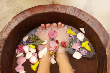 Hispanic woman receiving a foot massage and pedicure at luxury spa