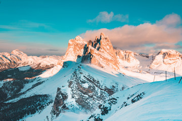 Dolomites mountain peaks at Seceda during sunset in winter, South Tyrol, Italy
