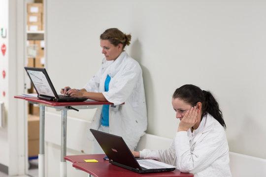 Nurses working on laptops
