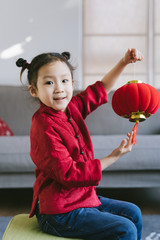 The portrait of a Chinese little girl holding a latern