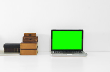 Mockup computer and office supply on desk and white background.