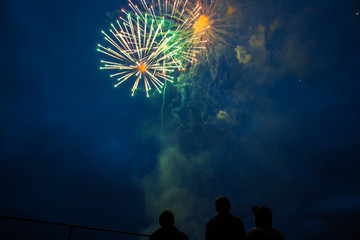 Fireworks celebration at night with friends watching