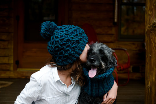 teen and her dog on cabin porch