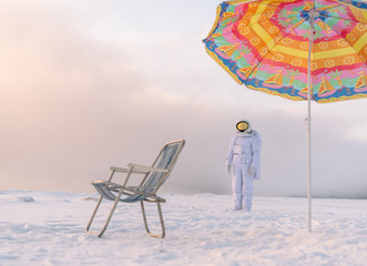 Astronaut at lounger in winter
