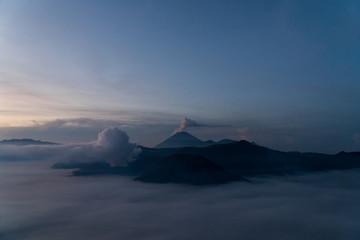 A pre dawn photo of a volcano erupting