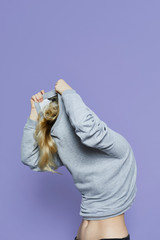 Unrecognizable woman posing in grey sweater