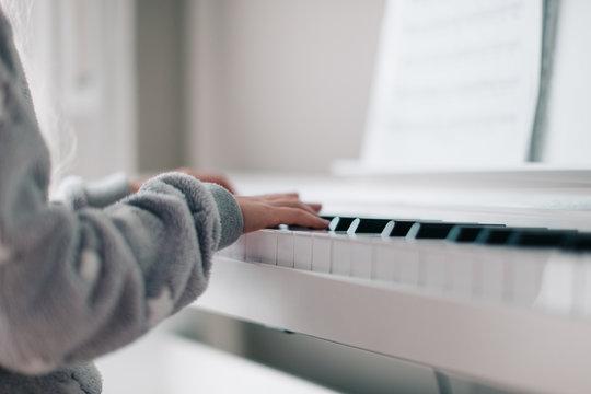 Kid playing piano