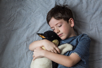 Snuggles with a penguin
