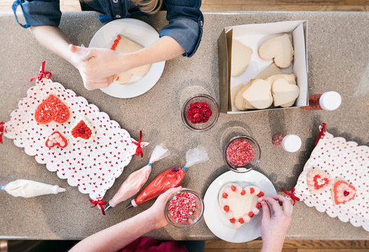 Valentine: Two Girls Decorating Holiday Heart Cookies