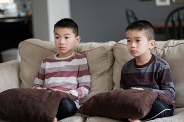 Two Asian Children Playing Video Games