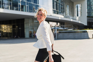 Happy businesswoman portrait in the city