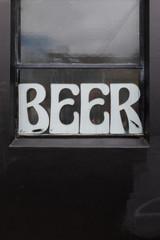Beer sign in window