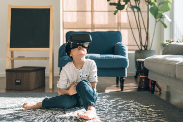 Boy wearing virtual glasses at home
