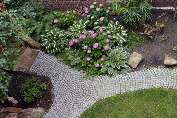 Brick path in a garden seen from above