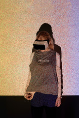 Woman exploring virtual night sky