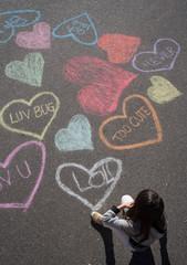 Heart chalk art and a little girl