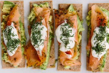 Smoked salmon and avocado on Finnish crisp-bread with sour cream and dill.