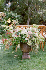 Rustic outdoor wedding ceremony flowers
