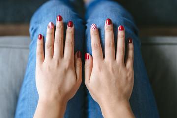 Beautiful young girl showing nail art