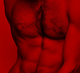 Unrecognisable strong man nude in studio - red