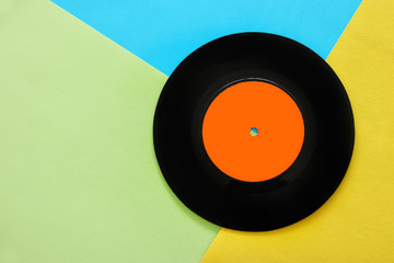 Retro record over pastel yellow and blue double color background. top view. copy space. Flat lay.
