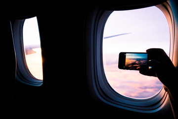 Taking a cellphone picture out the window of an airplane