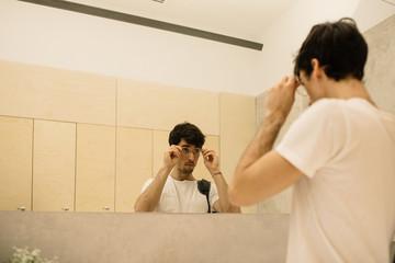 Man finishing dressing in cloakroom