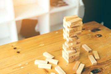 Blocks wood game (jenga) on wooden desk.