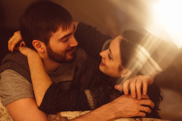 Embracing passionate couple in home cinema room
