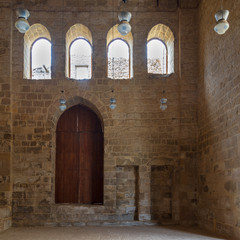 Public Mosque attached to Al-Muayyedi Bimaristan historic building, with wooden door and bricks stone wall, Darb Al Labana district, Old Cairo, Egypt