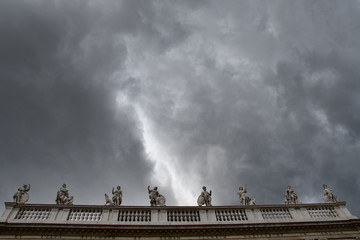 A stormy sky covers the statues of the palace